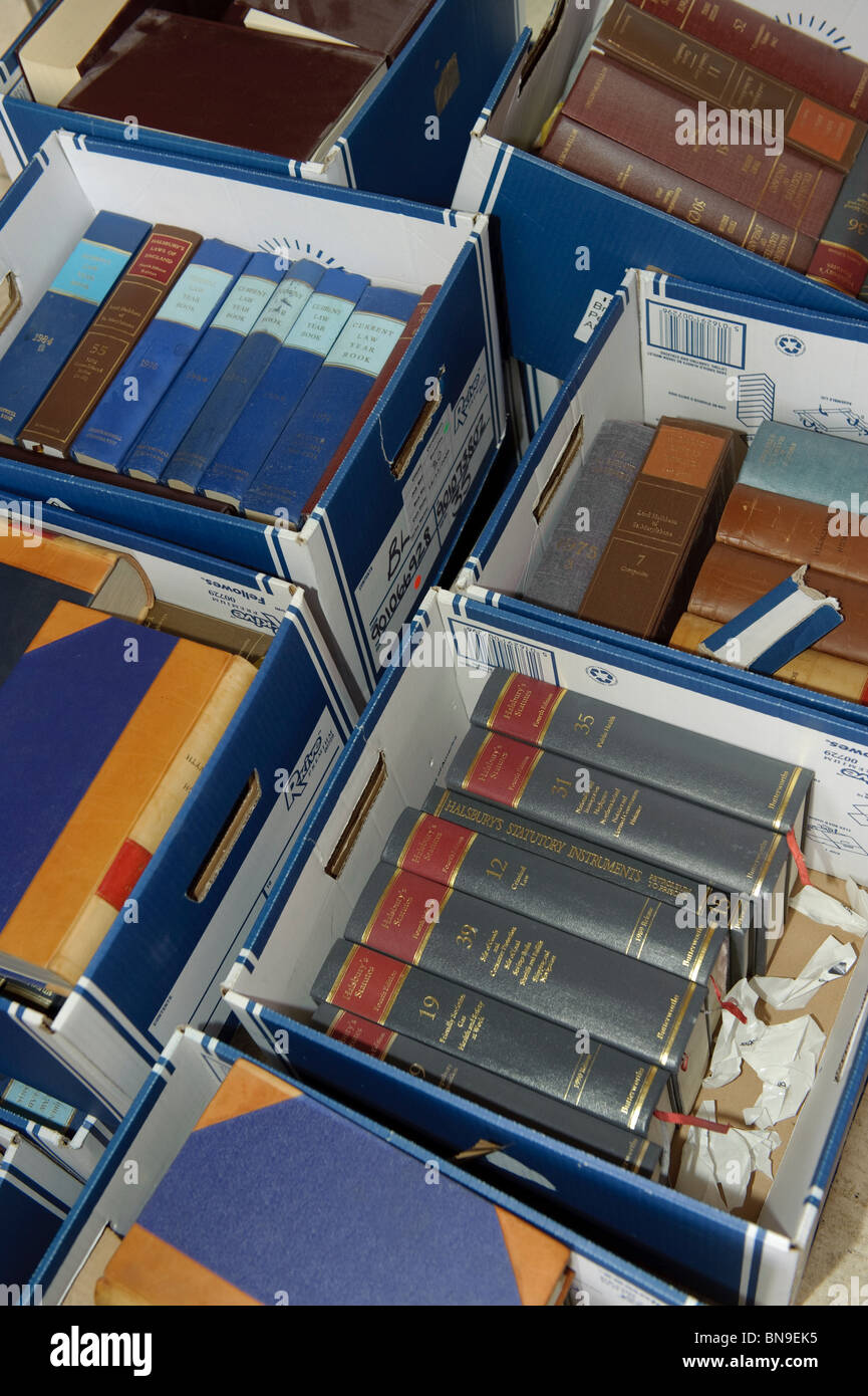 Cardboard boxes full of legal law books - local government moving offices UK - Stock Image