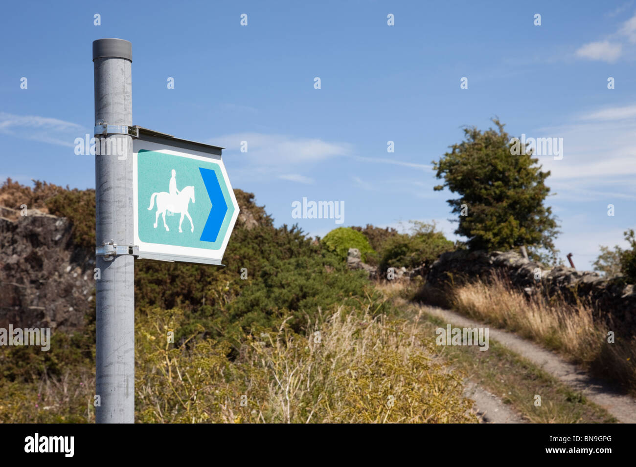 Bridleway sign pointing along a country bridlepath. Anglesey, Wales, UK, Britain. - Stock Image