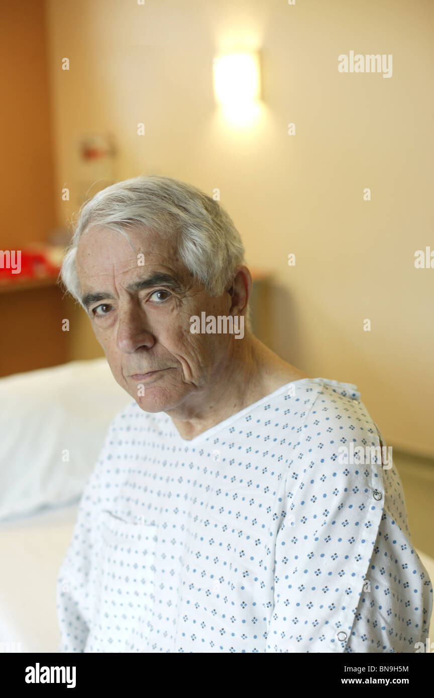 senior man in gown at hospital - Stock Image