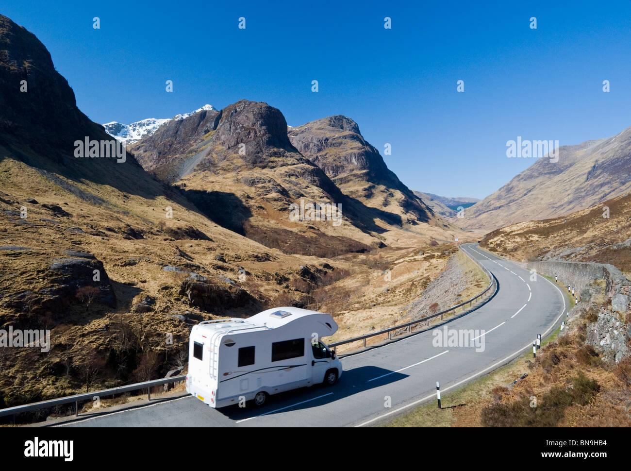 Motorhome travelling the road through Glencoe, Scottish Highlands, Scotland, UK - Stock Image
