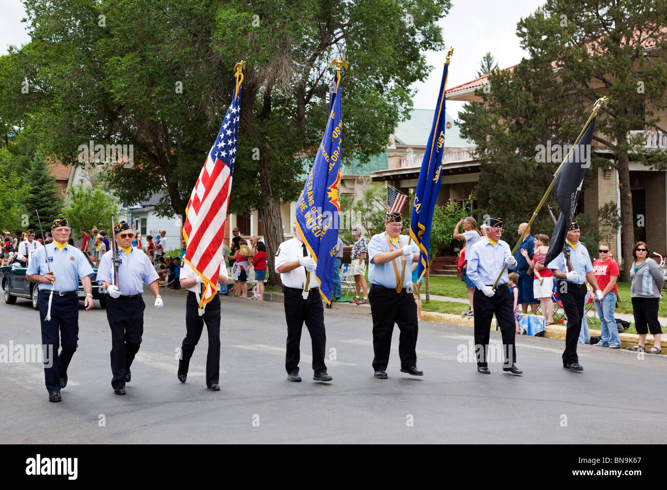 Veterans of Foreign Wars march in the color guard in a Fourth of July parade in the small mountain town of Salida, - Stock Image