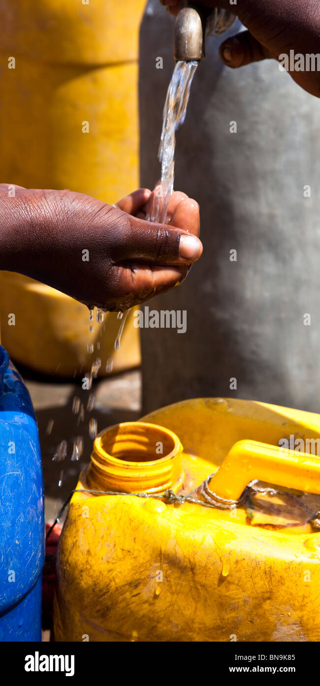 Water from a well in Ethiopia, Africa. - Stock Image