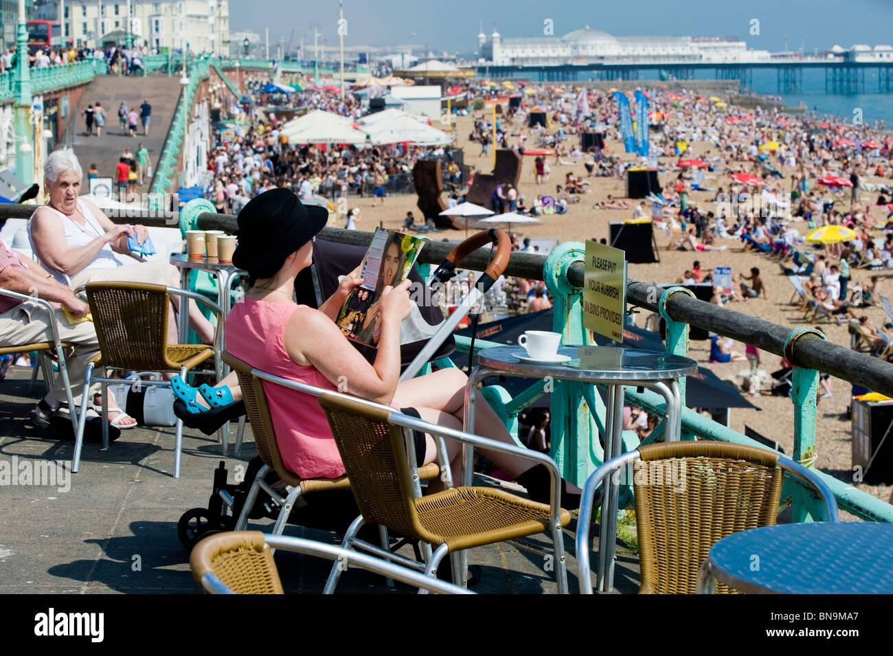 Crowded beach, Brighton, East Sussex, United Kingdom - Stock Image