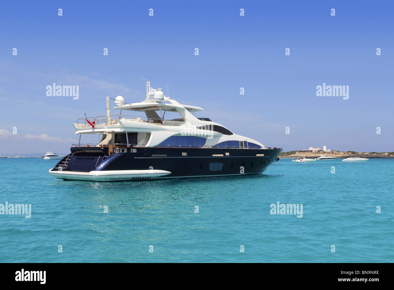 luxury yacht in turquoise Illetes Formentera mediterranean sea Balearic Islands - Stock Image