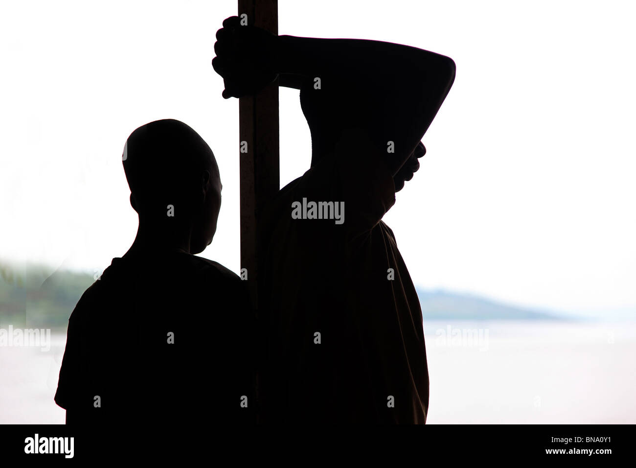 Silhouette of african boys - Stock Image