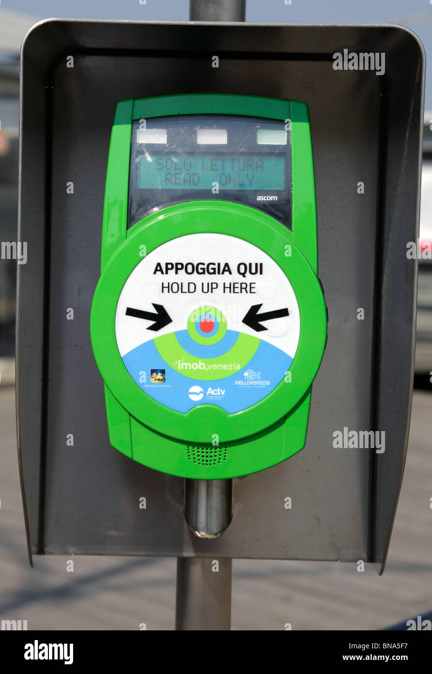 Automatic ticket machine used to validate tickets before boarding the ACTV vaporetto water bus Lido Venice Italy - Stock Image