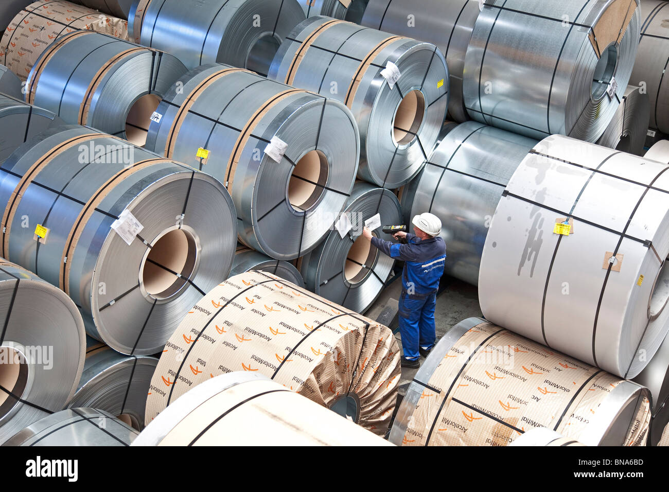 ArcelorMittal: production of steel coils; store of complete steel coils ready for shipping - Stock Image