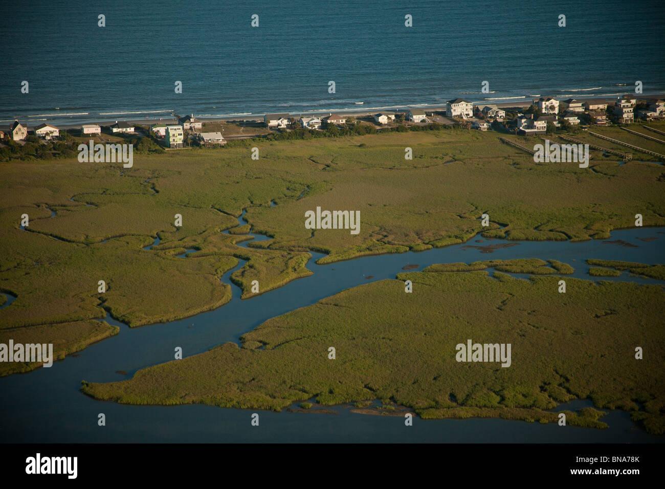 Homes along the coast on Folly Beach in Charleston, SC. - Stock Image