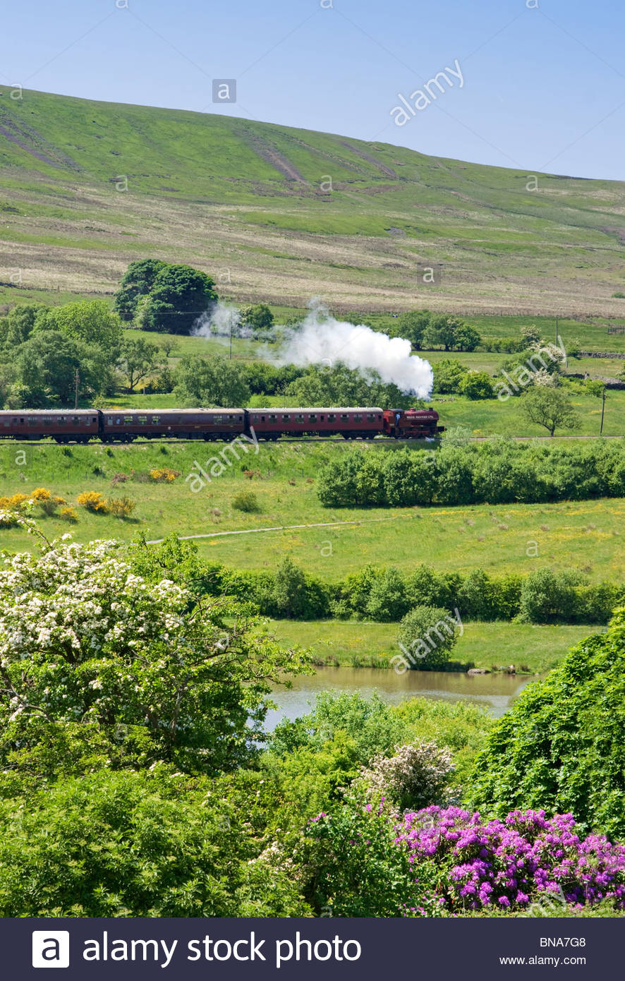 Steam train in Welsh landscape, Garn Lakes, Gwent, Wales, UK - Stock Image