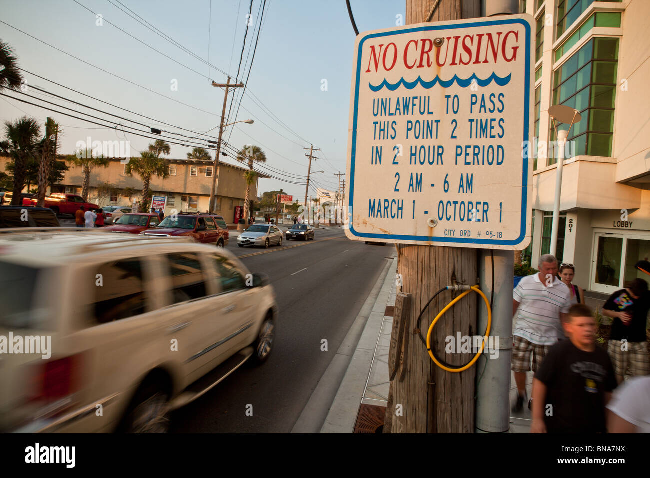 Sign forbidding cruising by car along the beach strip in Myrtle Beach, SC. - Stock Image