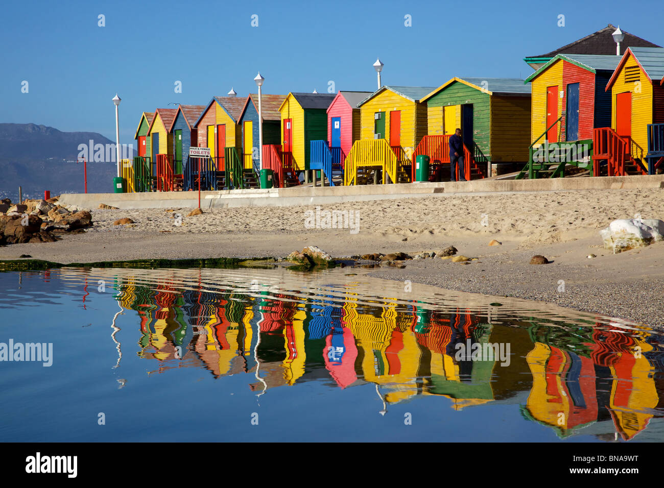 Brightly painted wooden bathing huts at St James Beach, near Cape Town, South Africa. Stock Photo