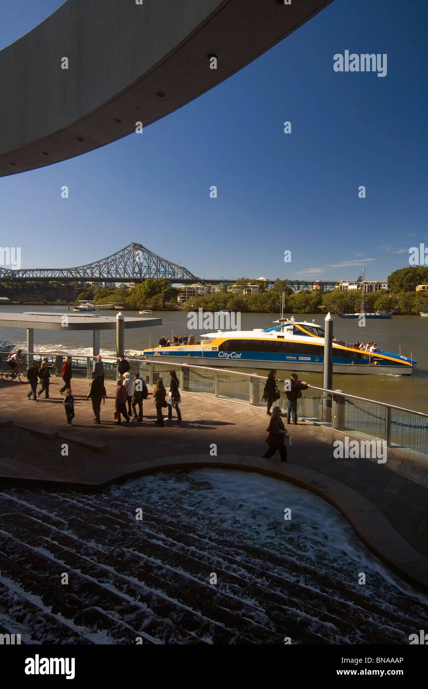 Citycat ferry leaving Riverside Centre, with Storey Bridge in background, Brisbane, Queensland, Australia. No PR - Stock Image