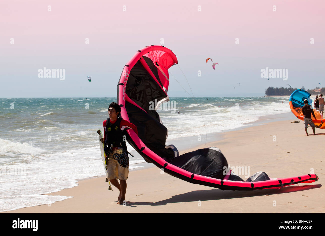Kitesurfing and view of beach and kitesurfers in action - Stock Image