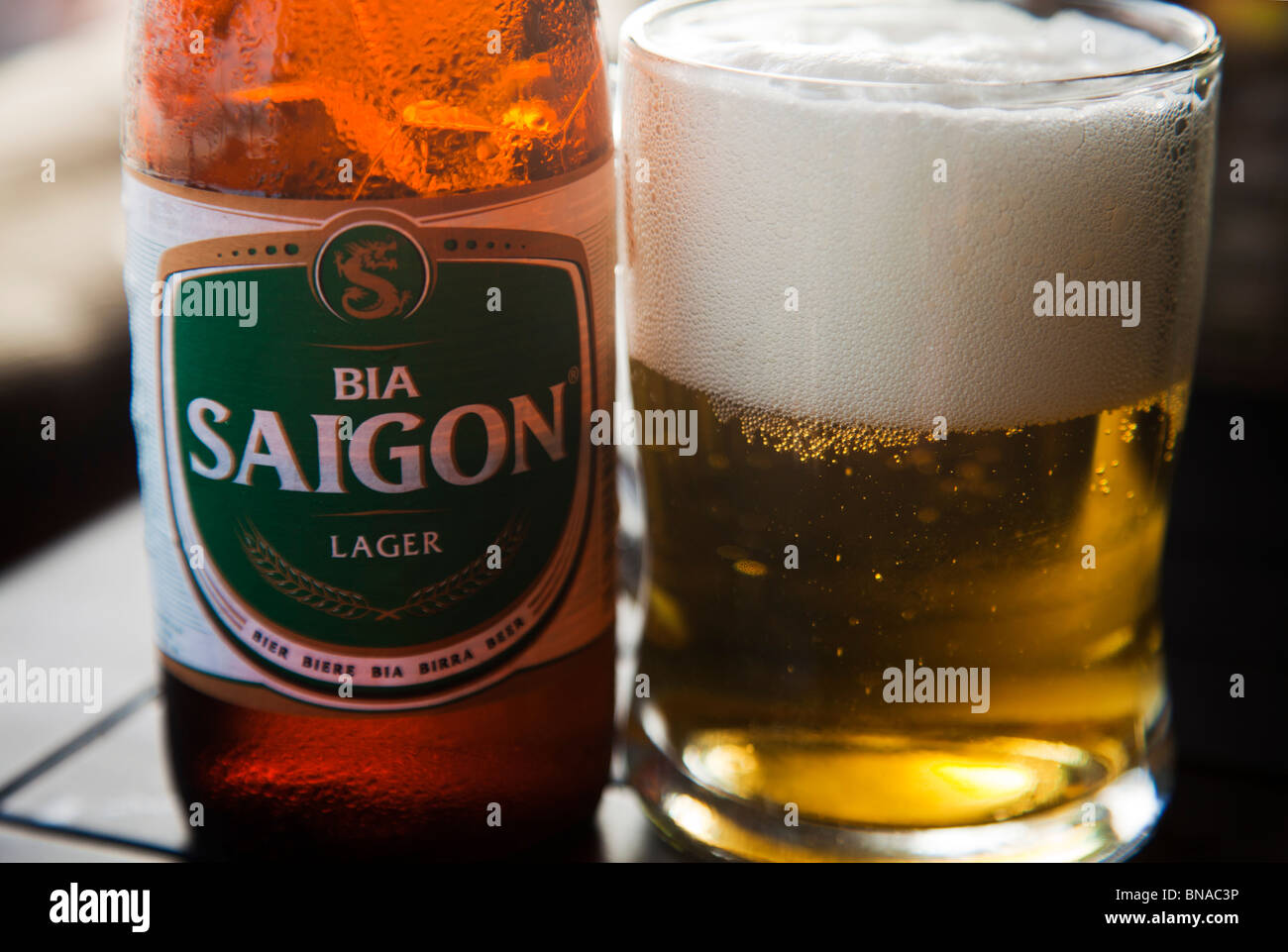 Vietnamese beer Sagon Green label with bottle and full glass - Stock Image