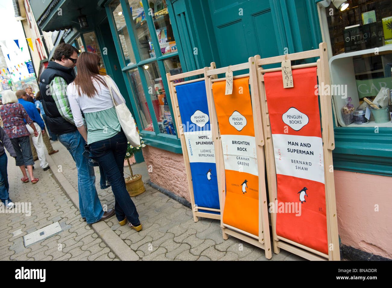 literary deckchairs branded penguin books for sale outside shop with