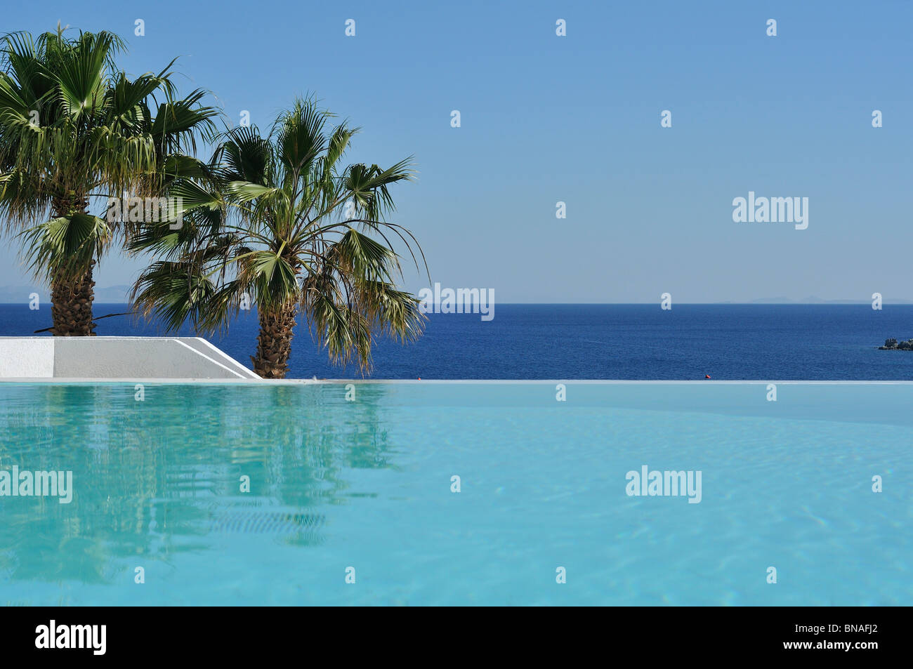 Mykonos. Greece. Infinity pool at Hotel Mykonos Blu, Psarou Beach. - Stock Image