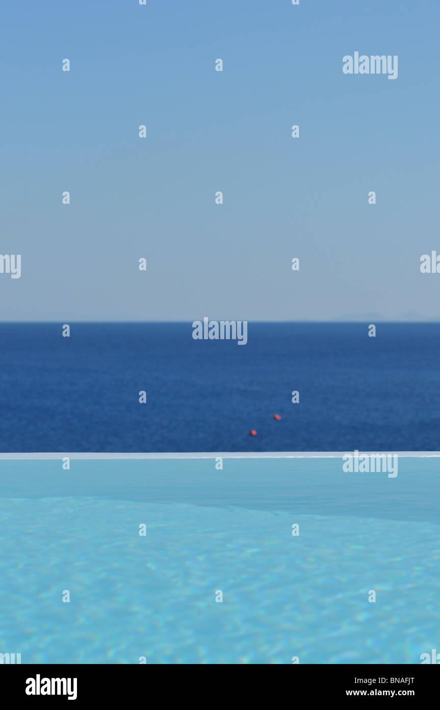 Mykonos. Greece. Infinity pool at Hotel Mykonos Blu, Psarou Beach. - Stock Image
