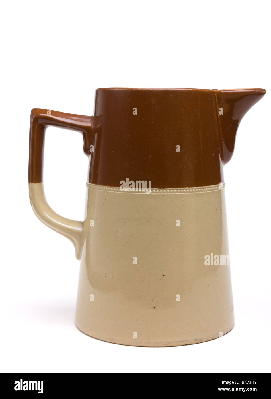 Vintage two tone Milk Jug isolated against white background. - Stock Image