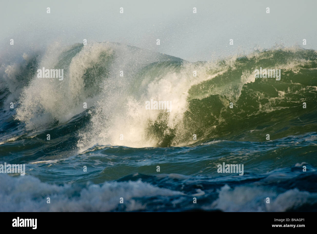 Waves crashing on rocks Kaikoura New Zealand - Stock Image
