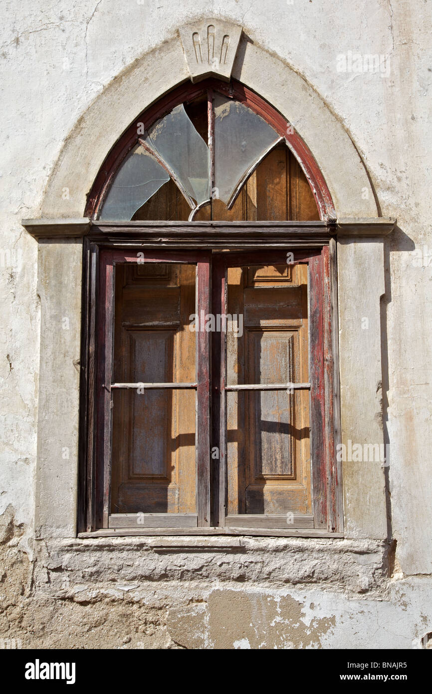 Medieval Red Wood Church Window with Broken Glass Panes Stock Photo