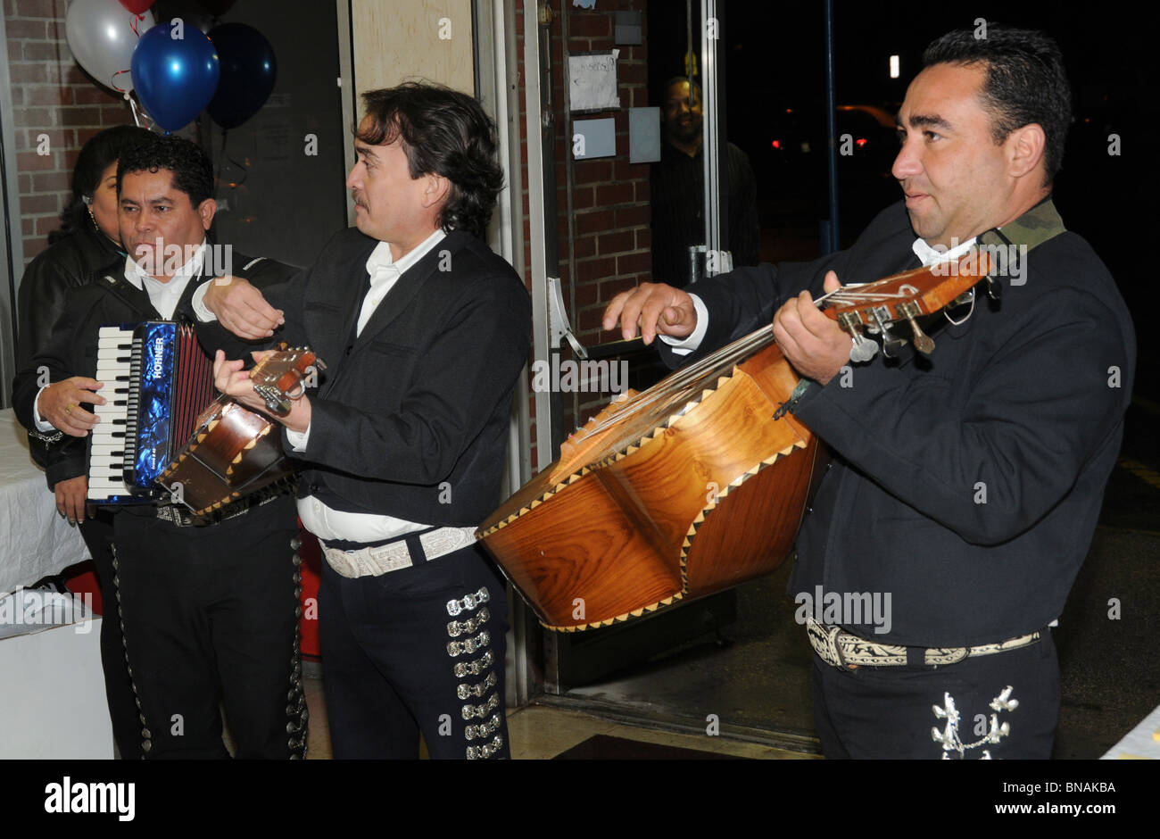 three Mexican musicians play at a political event in Forestville, Maryland - Stock Image