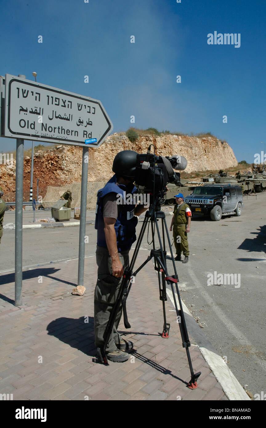 TV news crew wearing protective flak jacket filming Israeli