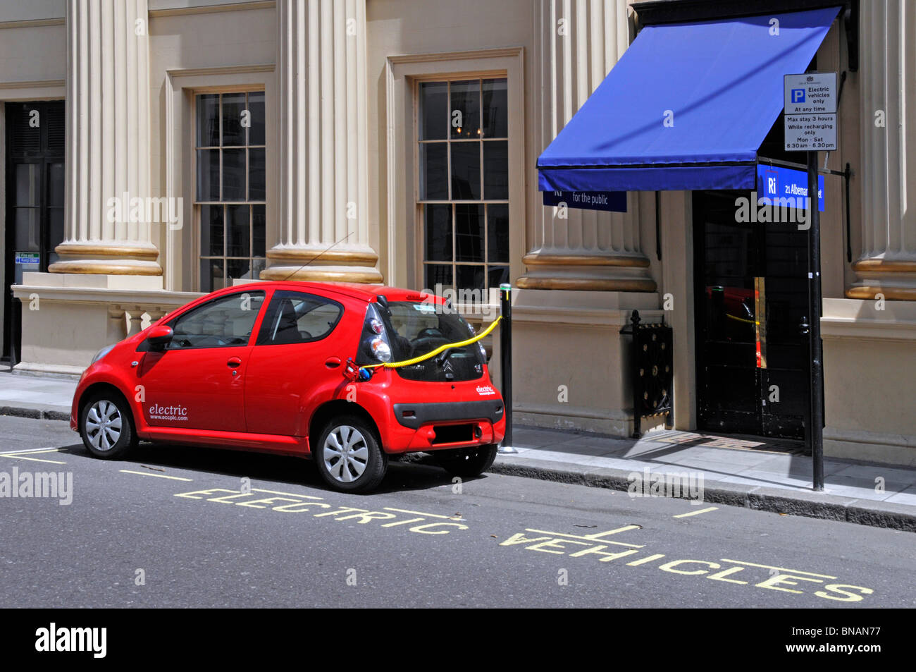 Environment & air pollution issues in London have resulted in dedicated vehicle bays for electric car use with - Stock Image