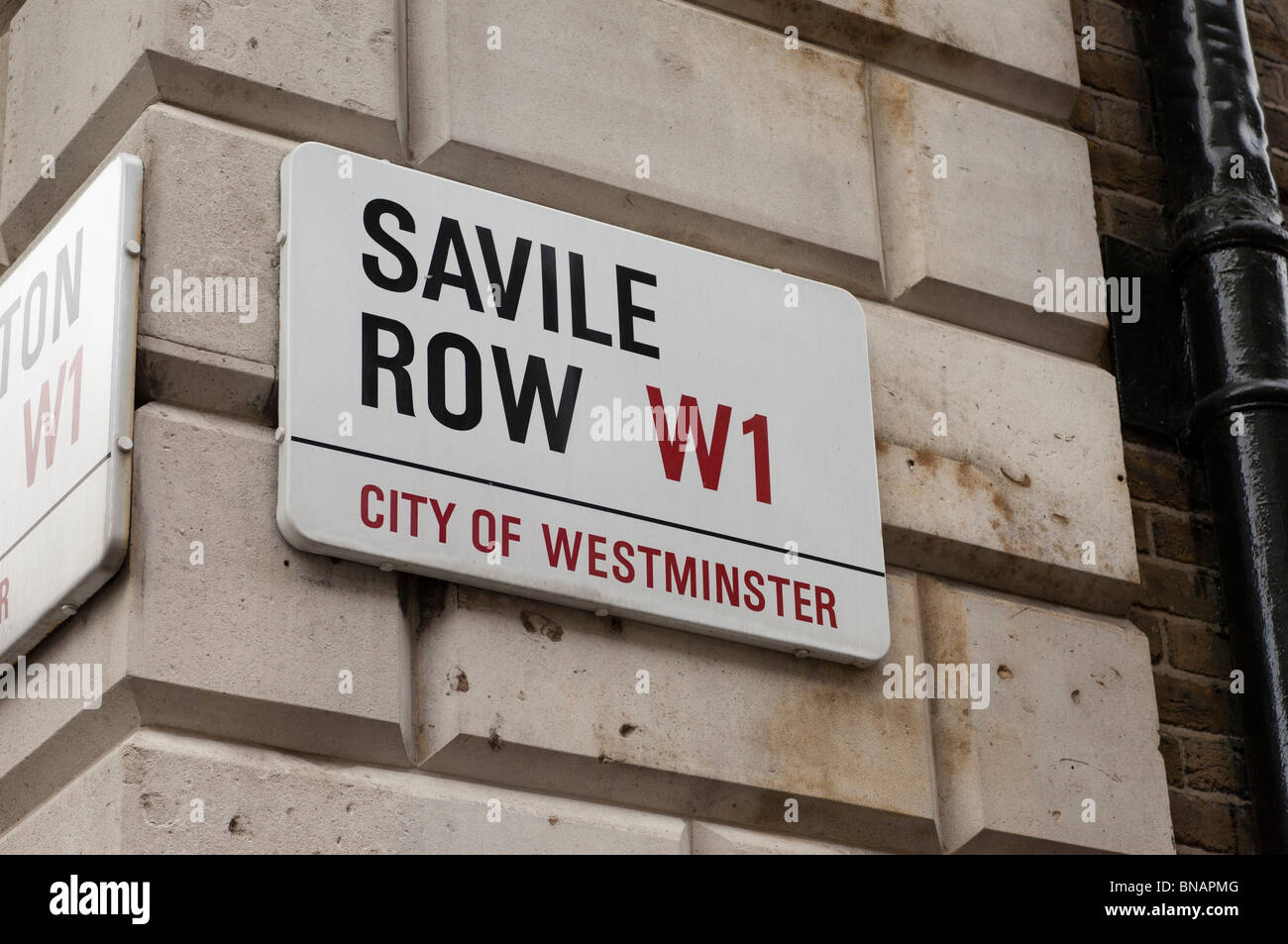 Saville Row street sign on the wall of a building. London W1, United Kingdom - Stock Image