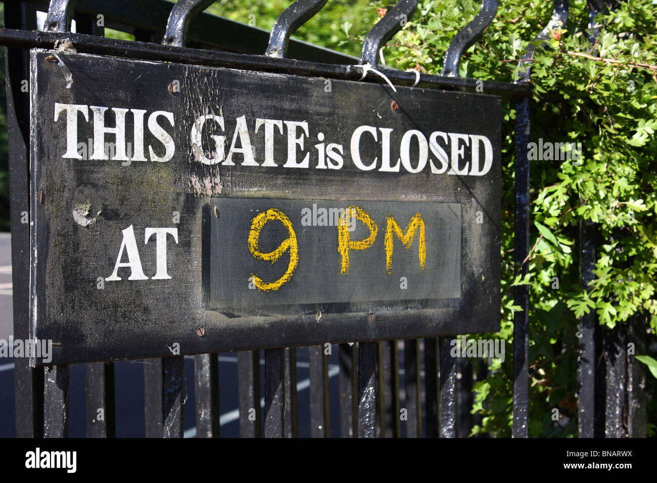 A sign on park gates in a U.K. city. - Stock Image