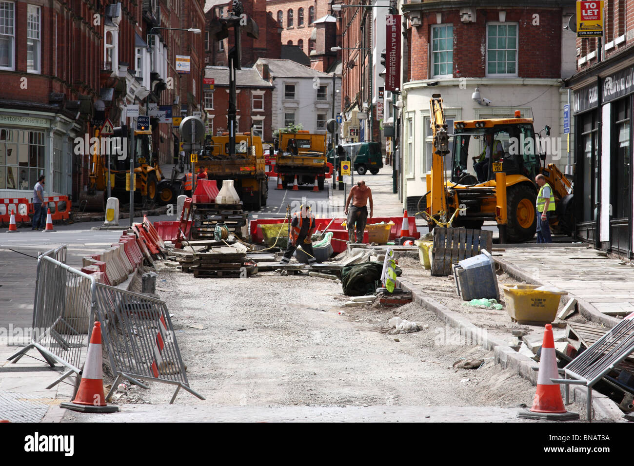 Roadworks in a U.K. city. - Stock Image