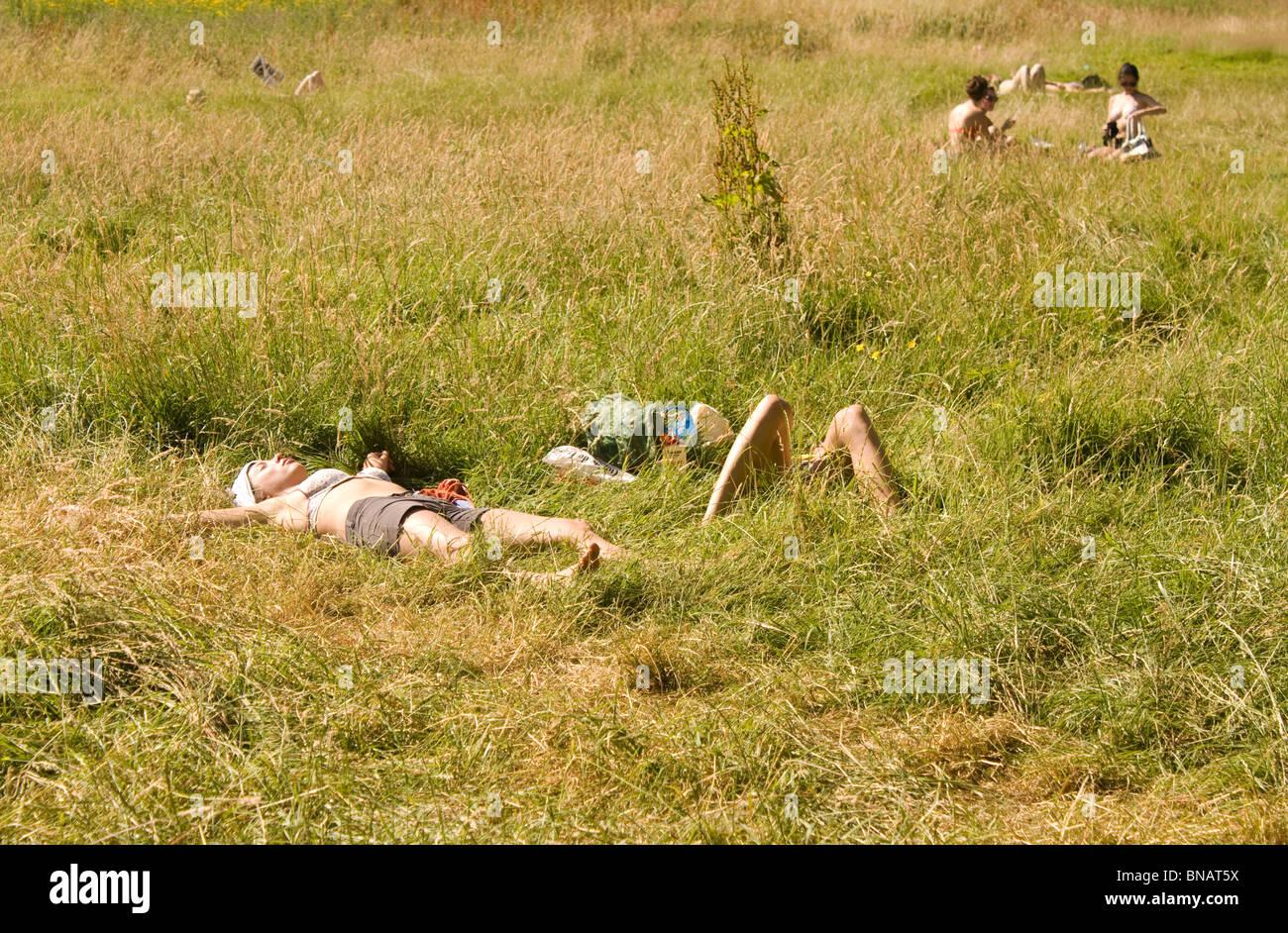 Sun Bathers in Hampstead Heath London, heat stroke Stock Photo