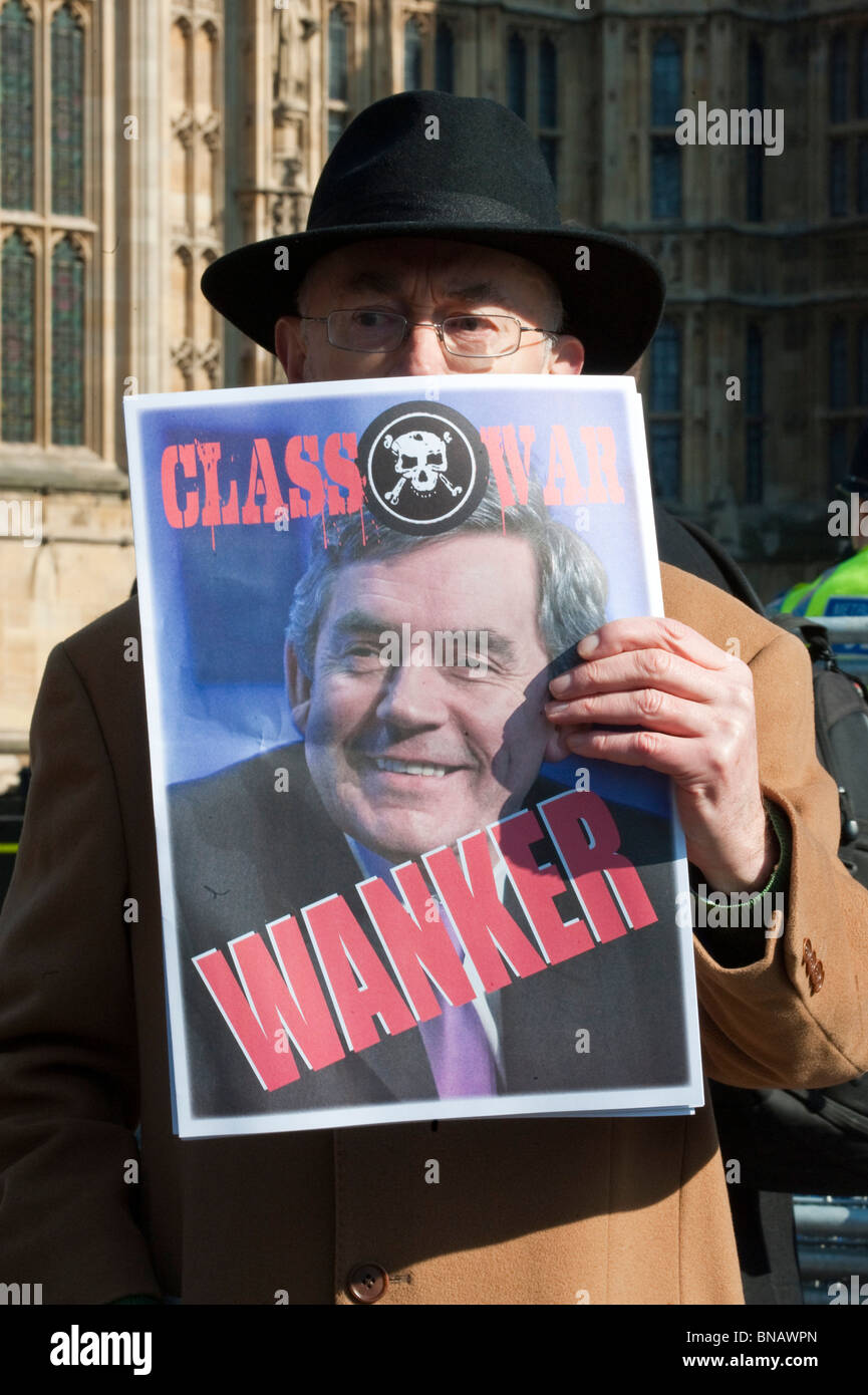 A protestor hold poster of Prime Minister on the day Gordon Brown arrives at the Iraq Inquiry on March 5, 2010  - Stock Image
