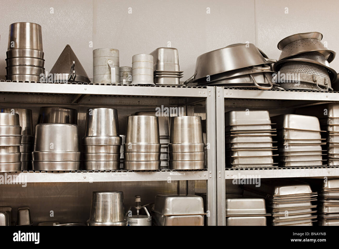 Kitchen utensils and baking tins, commercial kitchen - Stock Image