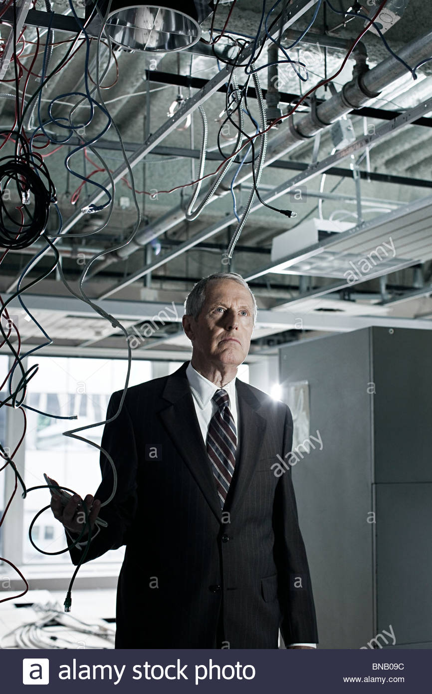 Businessman in abandoned office - Stock Image