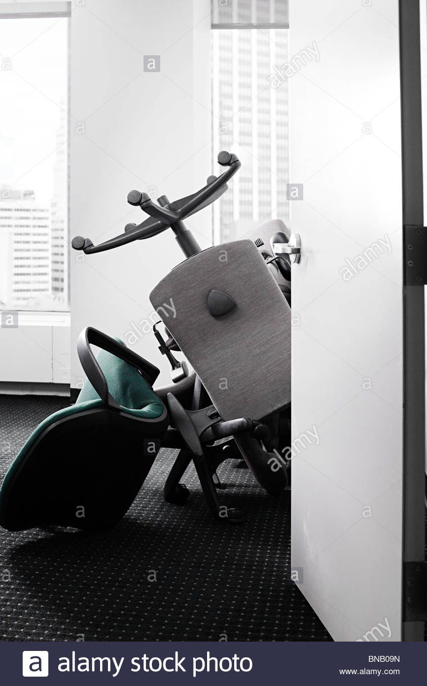 Pile of chairs in office - Stock Image
