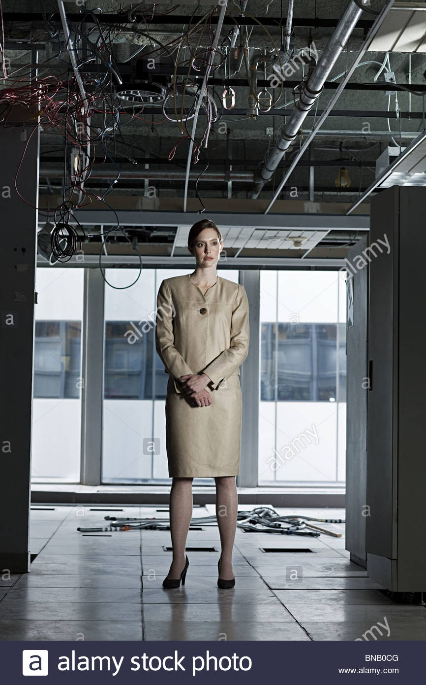 Businesswoman in abandoned office - Stock Image