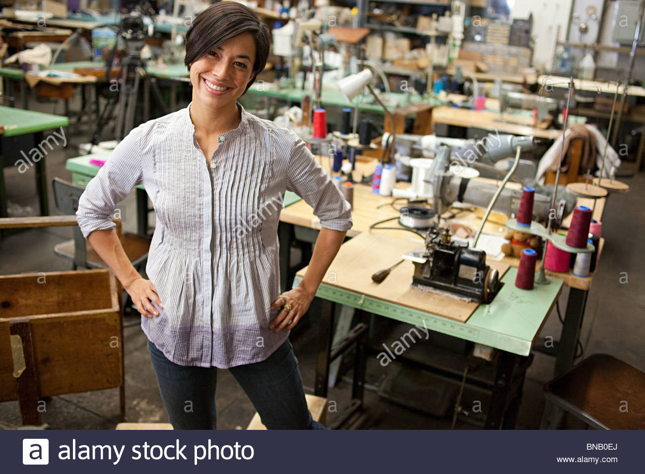 Seamstress in clothing factory - Stock Image