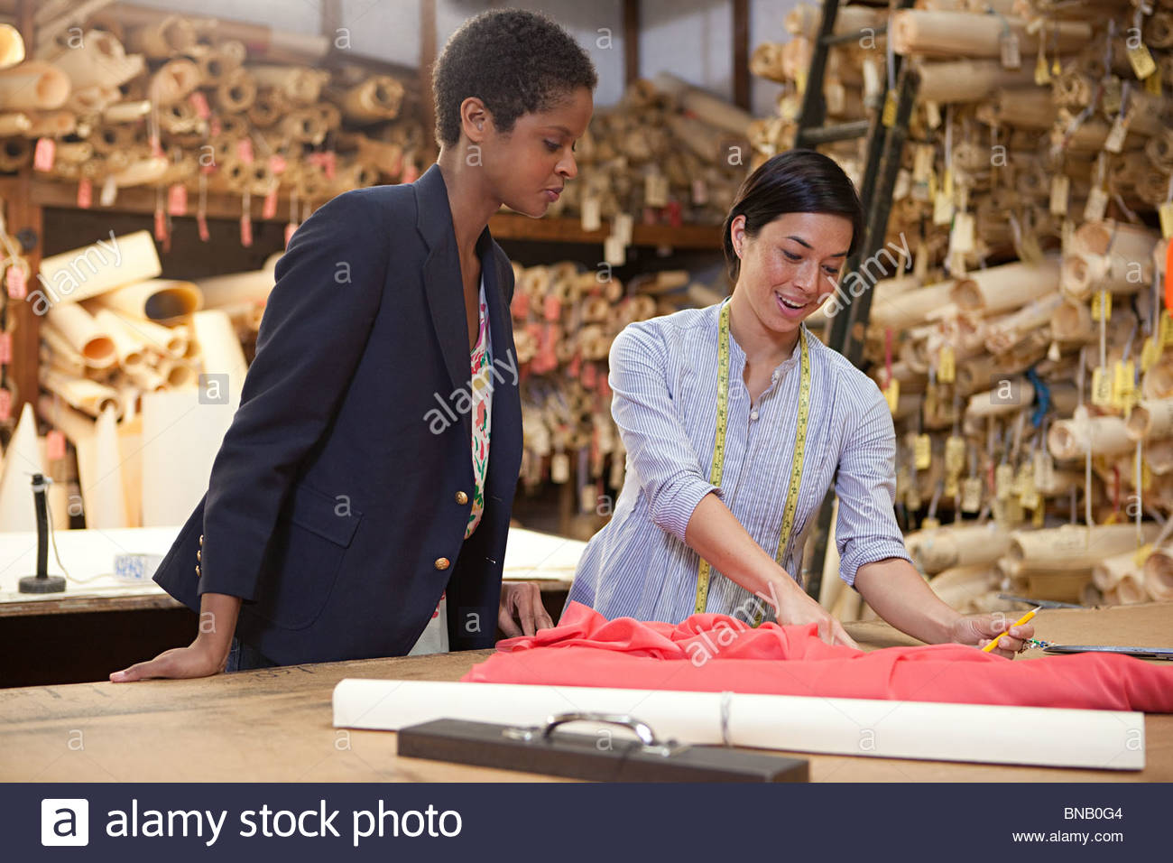 Colleagues in clothing factory - Stock Image