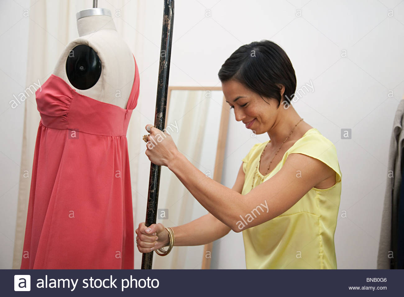 Shop assistant with mannequin - Stock Image