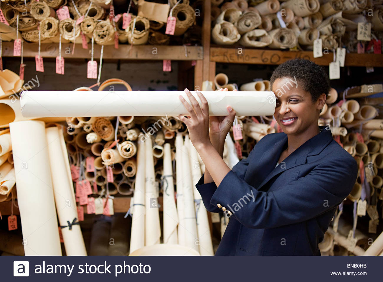 Fashion designer with rolled up patterns - Stock Image