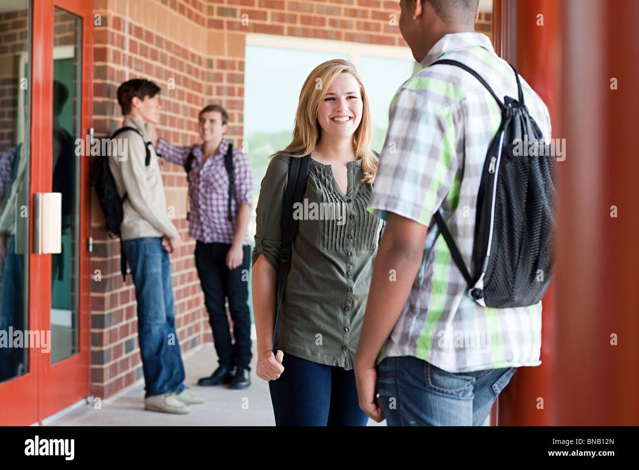 High school classmates chatting - Stock Image