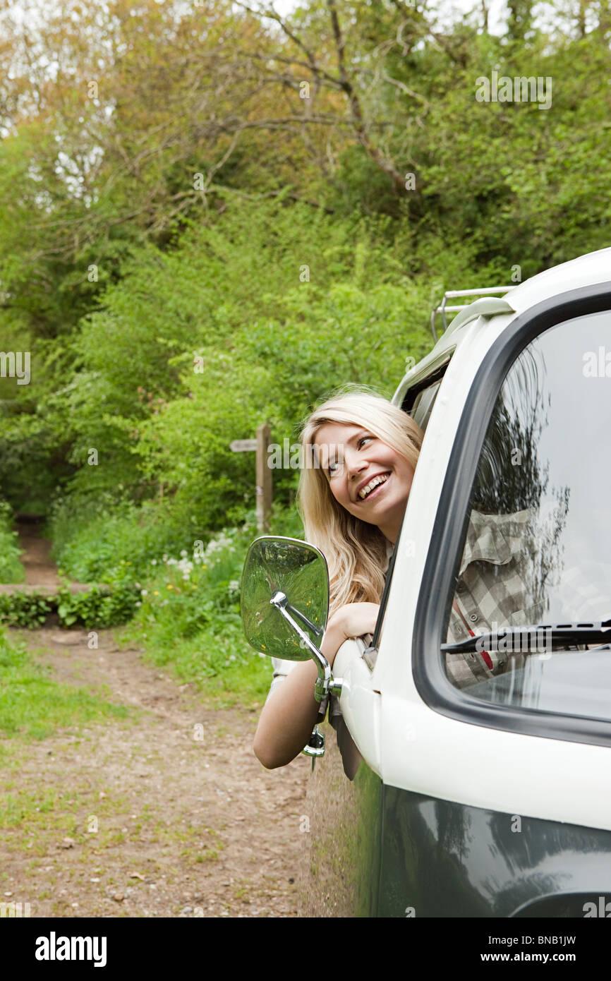 Young woman in camper van - Stock Image