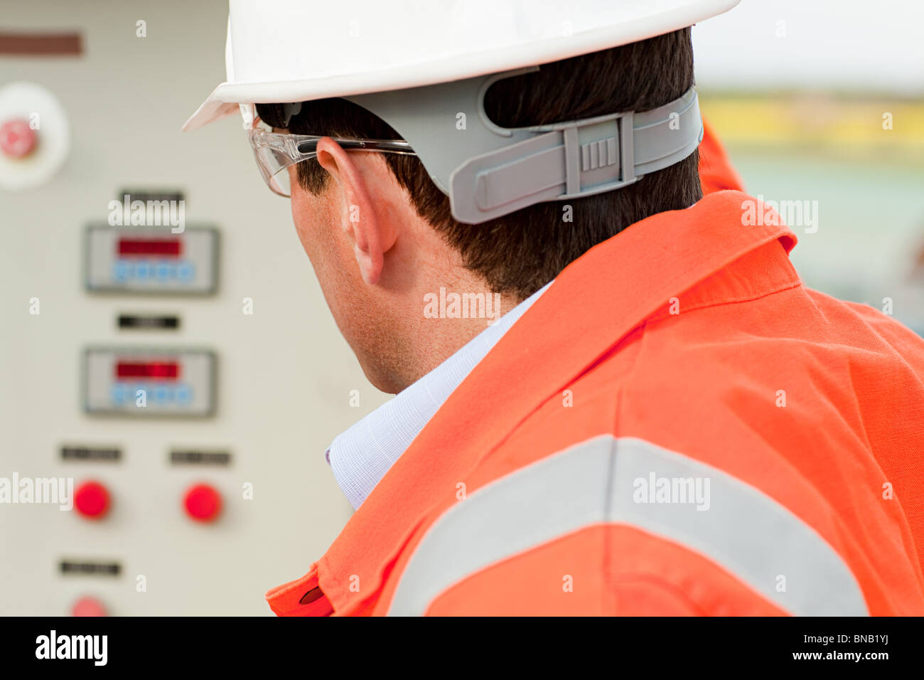 Engineer looking at control panel - Stock Image