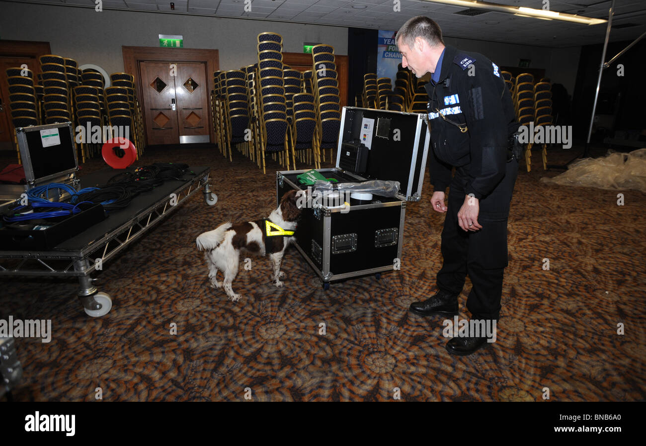 Sussex  Police officer and explosive search dog check items inside the Metropole Hotel before the Conservative spring - Stock Image