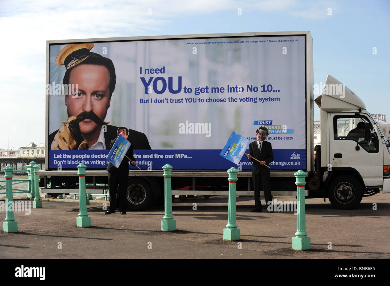 The vote for a change party use a defaced David Cameron poster to get their message across on Brighton Seafront - Stock Image