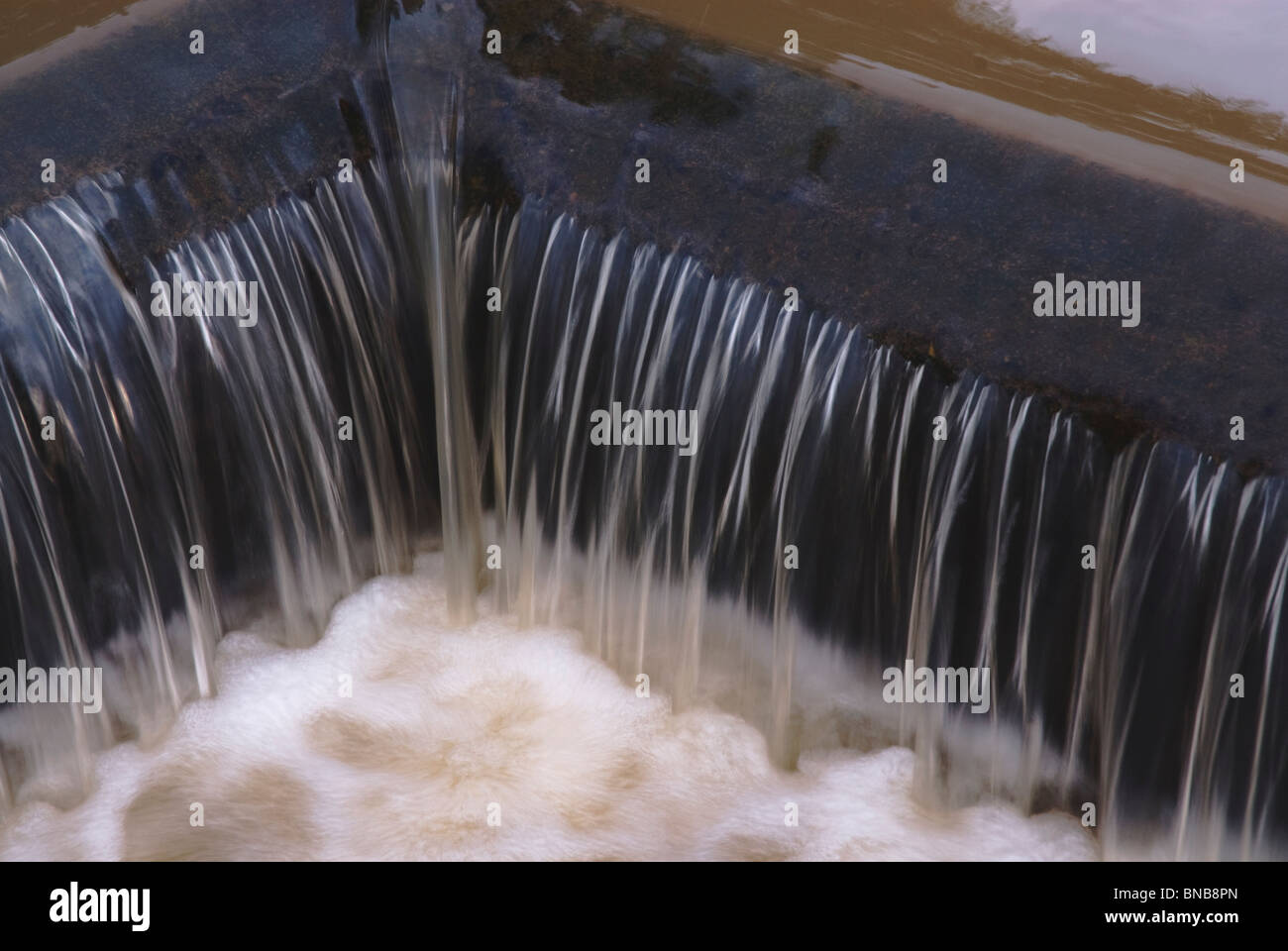 Close-up of a small waterfall. - Stock Image
