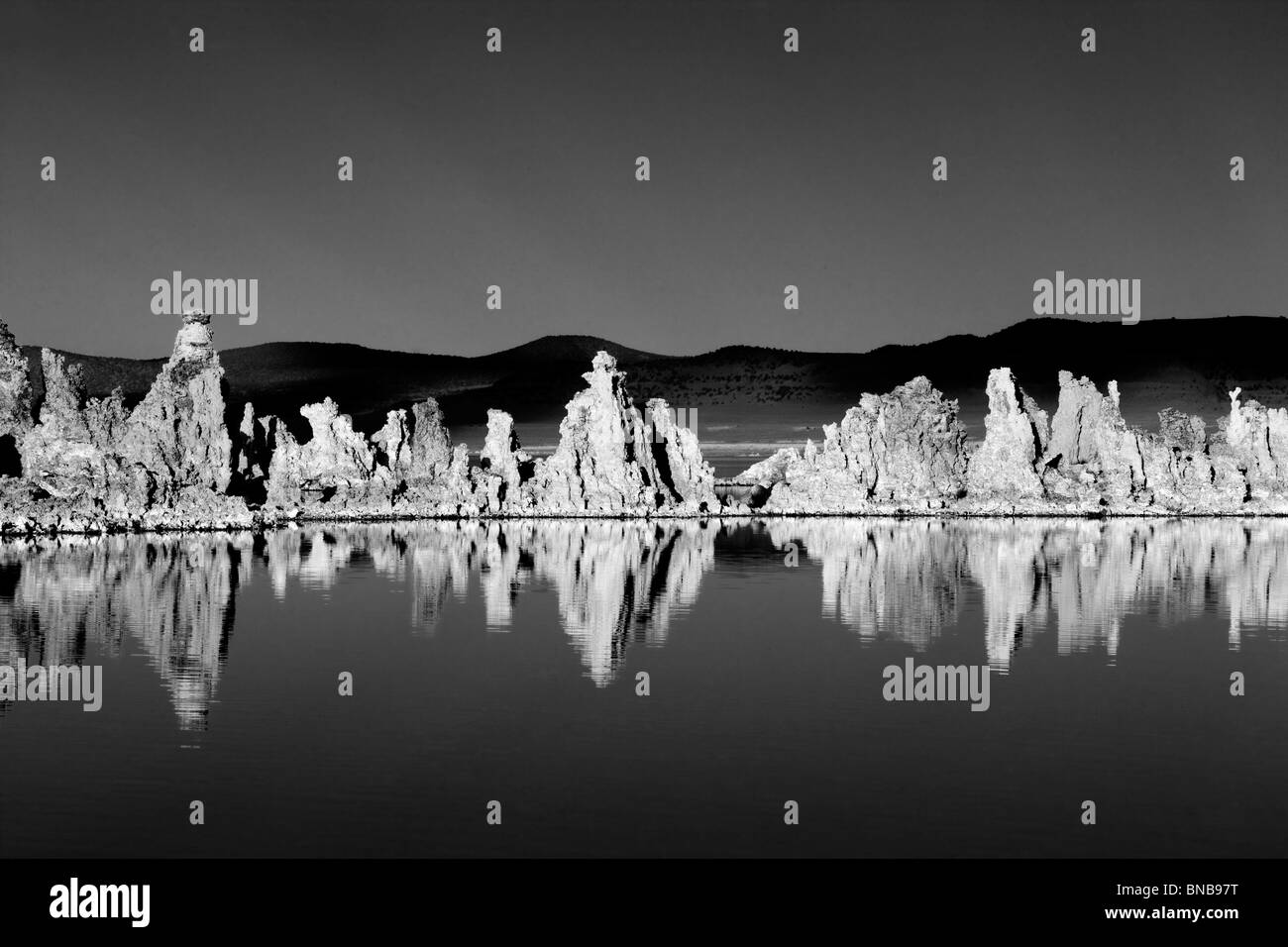Tufa and reflections in Mono Lake, California - Stock Image
