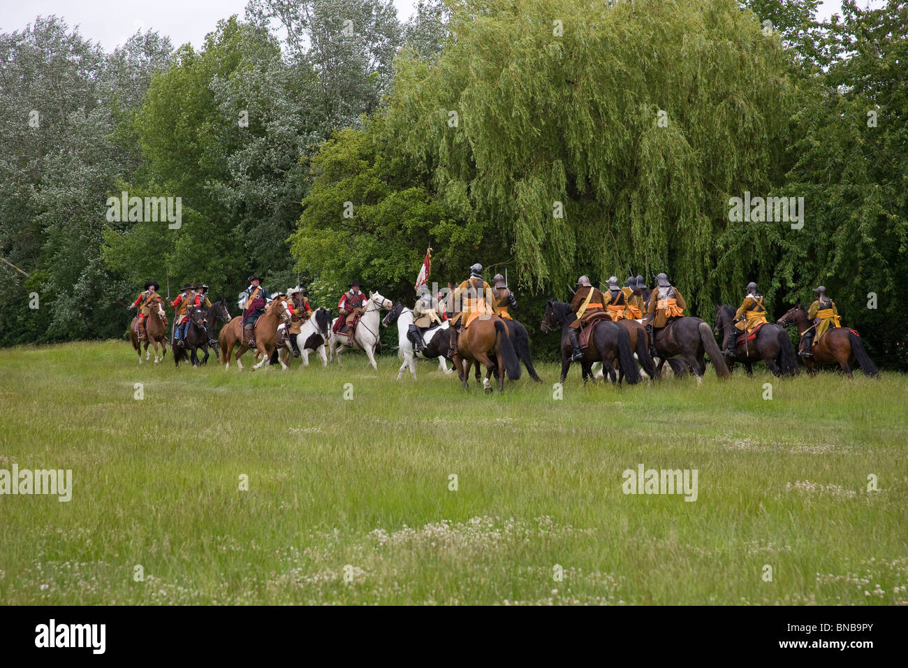 Cavalry of the Kings Army and the Roundhead Association come face to face during a skirmish. - Stock Image