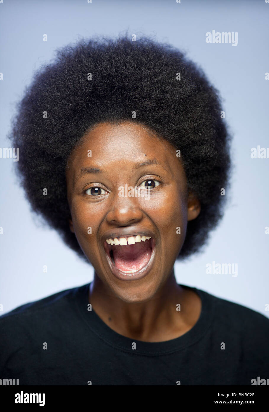 Close Up Portrait Of Joyful Young Black Woman With Afro