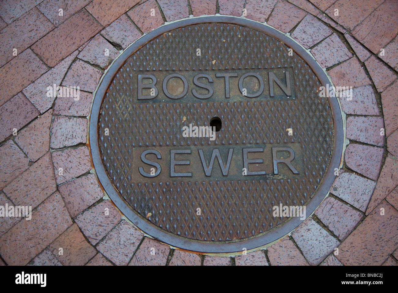 Boston, Massachusetts - A manhole cover on the Boston sewer system. - Stock Image